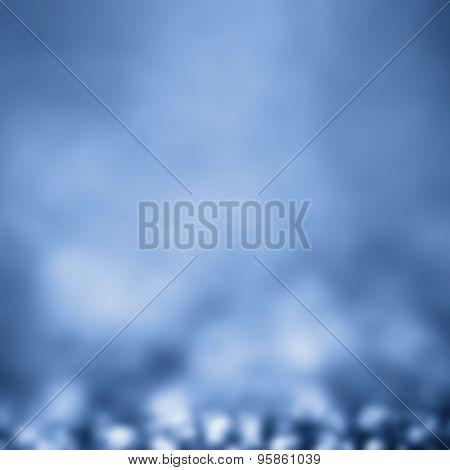 Blue Festive Christmas Elegant Abstract Background With Bokeh Light. Defocused White And Blue  Light