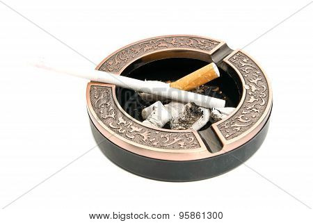 Cigarette In The Metal Ashtray With Butts