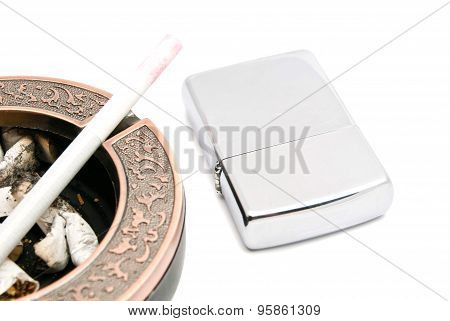 Ashtray With Cigarette And Butts, And Lighter