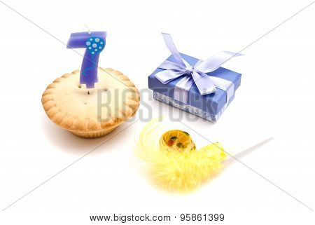 Cupcake With Seven Years Birthday Candle, Gift And Whistle On White