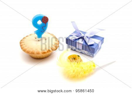Cupcake With Nine Years Birthday Candle, Gift And Whistle On White