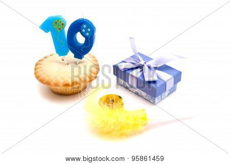 Cupcake With Ten Years Birthday Candle, Gift And Whistle On White