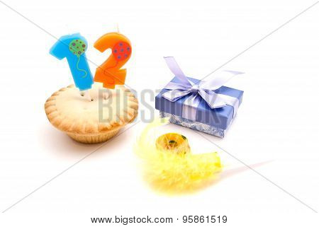 Cupcake With Twelve Years Birthday Candle, Gift And Whistle