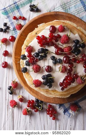 Crepes With Berries And Cream Close-up. Vertical Top View
