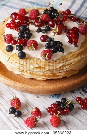 Pile Of Crepes With Berries Close-up On A Plate. Vertical
