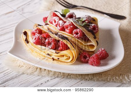 Crepes With Raspberry Berries And Chocolate Close-up