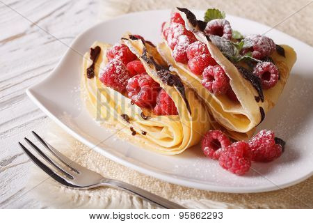 Delicious Raspberry Crepes Close-up On A Plate. Horizontal