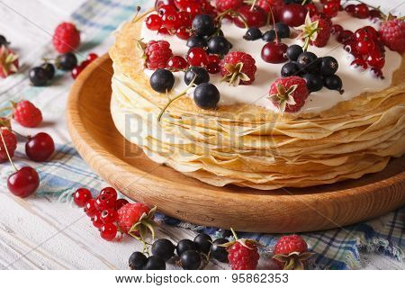 Stack Crepes With Berries Close-up On A Plate. Horizontal