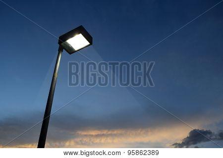 Pillar spotlights and light in evening .