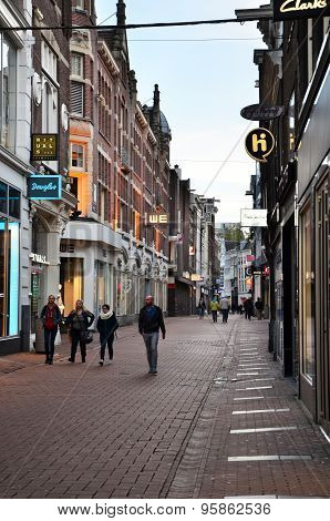 Amsterdam, Netherlands - May 7, 2015: Unidentified People Shopping On Kalverstraat