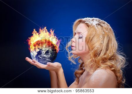Frozen girl holding burning earth globe (east hemisphere) in palms (elements furnished by NASA) - version with glowing