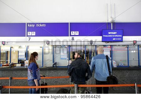 WARSAW, POLAND - SATURDAY, JUNE 6, 2015: Passengers on line to purchase tickets inside the main Polrail, PKP, train station in Warsaw.