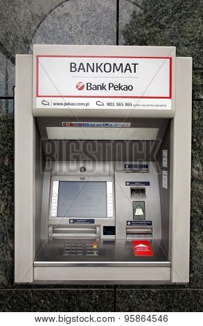 WARSAW, POLAND - SATURDAY, JUNE 6, 2015: A Bank Pekao ATM. Bank Polska Kasa Opieki Sp���³lka Akcyjna, commonly using the shorter name Bank Pekao S.A., is a  bank based in Warsaw