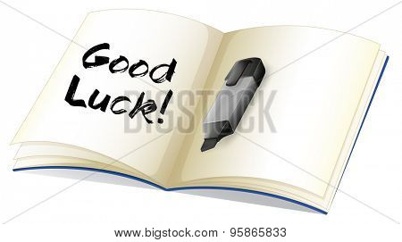 Open book with a message 'Good Luck!' written on it