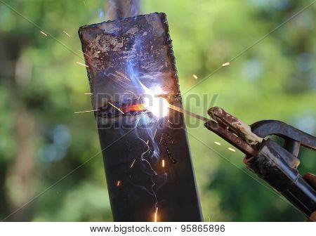 Hand Of Worker Welding Metal