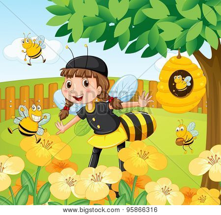 Girl in bee costume standing in a garden full of bees and flowers with a beehive on a tree