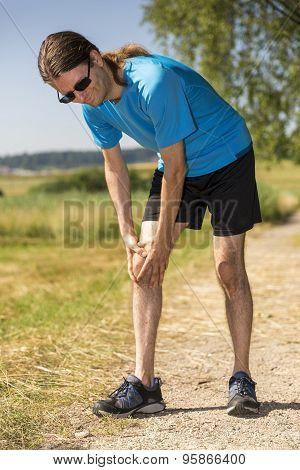 Jogger Having A Knee Pain