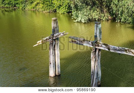 Parts Of A Forgotten Old Wooden Jetty