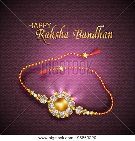 Beautiful shiny golden rakhi on purple background for Indian festival, Happy Raksha Bandhan celebration.