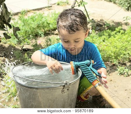 A Boy Plays With Water