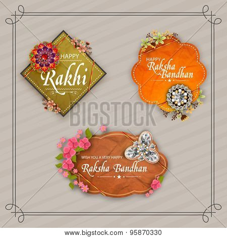 Beautiful creative rakhi and flowers decorated sticker, tag or label design on stylish background for Indian festival, Raksha Bandhan celebration.