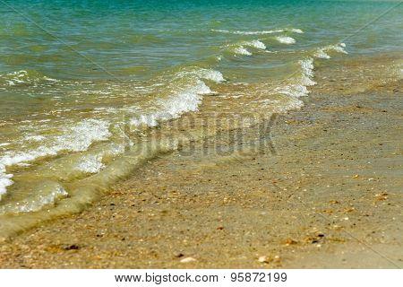 Waves lapping beach, UK