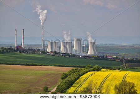 Rape Seed Field And Power Plant In The Background