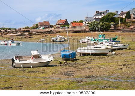 Ships By Ebb-tide In Harbor Of Ploumanach, Brittany, France