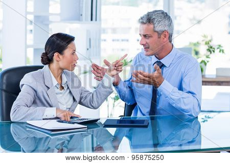 Business people having argument in office