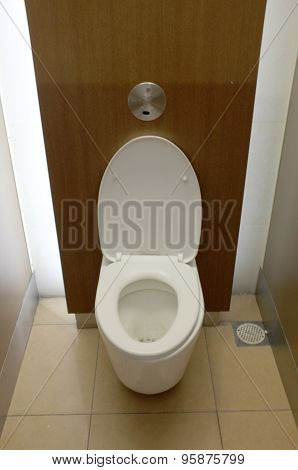 White toilet bowl in modern public rest room
