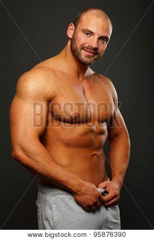 Smiling muscular man