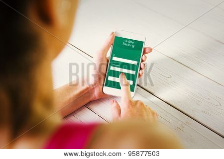 Woman using her smartphone against online banking