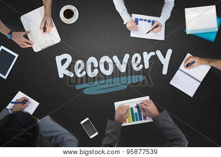 The word recovery and business meeting against blackboard
