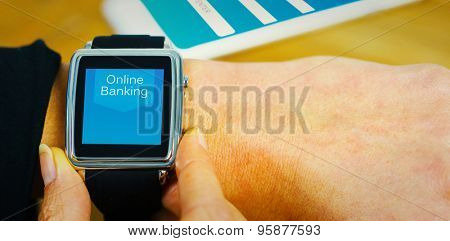 Businesswoman with smart watch on wrist against online banking
