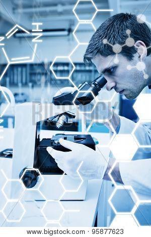 Science graphic against scientific researcher using microscope in the laboratory