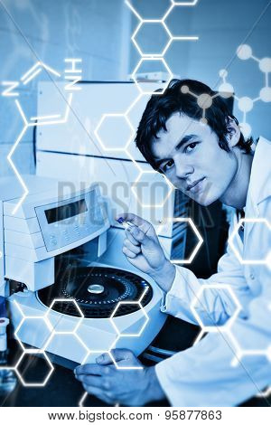 Science graphic against portrait of a a student posing with a centrifuge