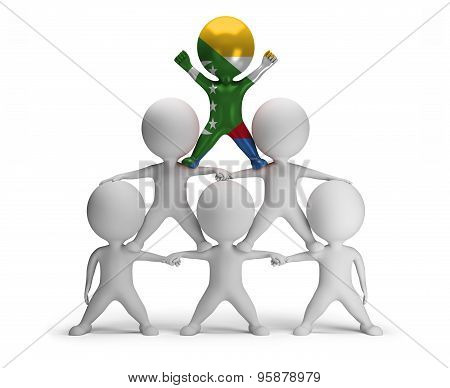 3d small people standing on each other in the form of a pyramid with the top leader Comoros