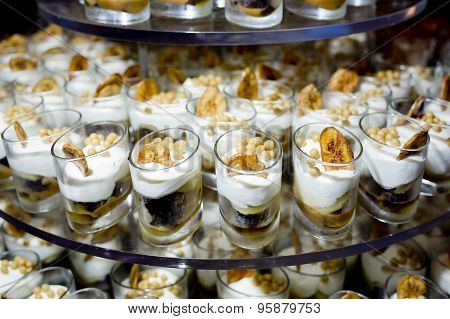Dessert Finger Food With Banana Topping In Small Glass