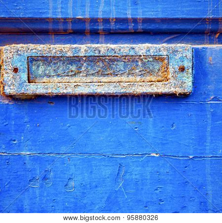 Dirty Stripped Paint In The Blue Wood Door And Rusty Nail