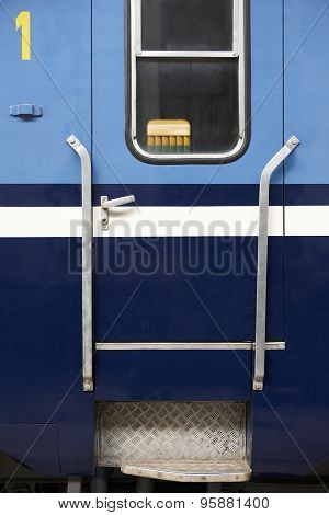 Blue Train Wagon Entrance Door In A Railway Station