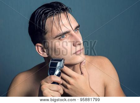 Fashion portrait of male chin and electric shaver