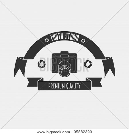 The Layout For The Studio Logo In Vintage Style With A Camera And ribbons.