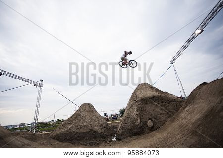 Bontida, Romania - June 27, 2015: Unidentified BMX rider making a bike jump during the BMX Competition, at Electric Castle Festival, Bontida, Romania