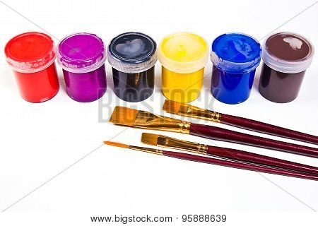 Bottles With Gouache Paints And Different Kinds Of Brushes For Artistic Paintings.