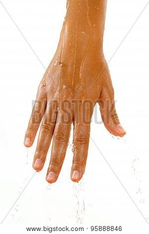 Close-up Of Female Hand In Oil And Pouring Water