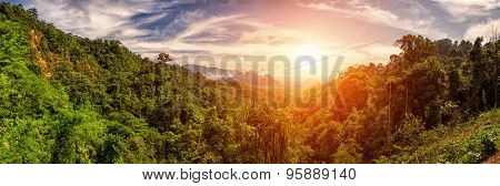 Bright Sunset with Panoramic view over Kao Sok Lush Rainforests, Thailand