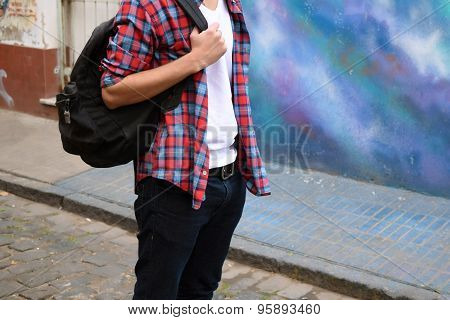 Young Stylish Man With A Bagpack.
