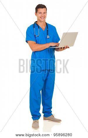 full length portrait of male nurse using laptop computer