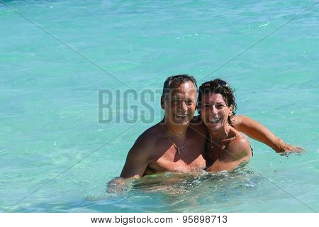 Love Couple Embracing In The Caribbean Sea