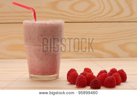 Smoothie From Raspberries  In A Glass And Raspberries  On Wooden Table